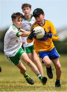 1 July 2018; Tim Fitzpatrick of Ratoath in action against Logan Woods of Burren GAC during the John West Féile Peil na nÓg National Competitions 2018 match between Ratoath and Burren GAC at Stamullen GAA in Meath. This is the third year that the Féile na nGael and Féile Peile na nÓg have been sponsored by John West, one of the world's leading suppliers of fish. The competition gives up-and-coming GAA superstars the chance to participate and play in their respective Féile tournament, at a level which suits their age, skills and strengths. Photo by Harry Murphy/Sportsfile