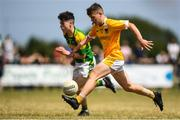 1 July 2018; Eoghan McAlinden of Clonduff GAC in action against Jack Ramsay of Claregalway during the John West Féile Peil na nÓg National Competitions 2018 match between Claregalway and Clonduff GAC at Stamullen GAA in Meath. This is the third year that the Féile na nGael and Féile Peile na nÓg have been sponsored by John West, one of the world's leading suppliers of fish. The competition gives up-and-coming GAA superstars the chance to participate and play in their respective Féile tournament, at a level which suits their age, skills and strengths. Photo by Harry Murphy/Sportsfile