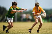 1 July 2018; Callum Donnan of Clonduff GAC in action against Jake Buckley of Claregalway during the John West Féile Peil na nÓg National Competitions 2018 match between Claregalway and Clonduff GAC at Stamullen GAA in Meath. This is the third year that the Féile na nGael and Féile Peile na nÓg have been sponsored by John West, one of the world's leading suppliers of fish. The competition gives up-and-coming GAA superstars the chance to participate and play in their respective Féile tournament, at a level which suits their age, skills and strengths. Photo by Harry Murphy/Sportsfile