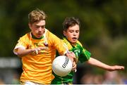 1 July 2018; Adam Fegan of Clonduff GAC in action against Gerard O Riordan of Claregalway during the John West Féile Peil na nÓg National Competitions 2018 match between Claregalway and Clonduff GAC at Stamullen GAA in Meath. This is the third year that the Féile na nGael and Féile Peile na nÓg have been sponsored by John West, one of the world's leading suppliers of fish. The competition gives up-and-coming GAA superstars the chance to participate and play in their respective Féile tournament, at a level which suits their age, skills and strengths. Photo by Harry Murphy/Sportsfile