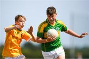 1 July 2018; Tom Nolan of Claregalway in action against Daniel McPolin of Clonduff GAC during the John West Féile Peil na nÓg National Competitions 2018 match between Claregalway and Clonduff GAC at Stamullen GAA in Meath. This is the third year that the Féile na nGael and Féile Peile na nÓg have been sponsored by John West, one of the world's leading suppliers of fish. The competition gives up-and-coming GAA superstars the chance to participate and play in their respective Féile tournament, at a level which suits their age, skills and strengths. Photo by Harry Murphy/Sportsfile