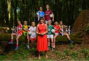 3 July 2018; Breaking new ground: Top inter-county stars took in the breath-taking scenery at Mullaghmeen Forest in county Westmeath, to launch the revamped 2018 TG4 All-Ireland championships. TG4 have announced a four-year extension of their sponsorship of the Ladies Football championships, with the new deal set to last until the conclusion of the 2022 season. 17 Ladies Football championship games will be broadcast this summer exclusively live on TG4, with the senior and intermediate championships to be played on a new, round-robin basis. Pictured are, from left, Rebecca Carr of Louth with Karen Guthrie of Donegal, Neamh Woods of Tyrone, behind, Niamh McEvoy of Dublin and Áine McDonagh of Galway, Cathy Mee of Limerick, Melissa Duggan of Cork along with Laurie Ryan of Clare and in the centre, Presenter and Producer on TG4, Gráinne McElwain at Mullaghmeen Forest, Co. Westmeath. Photo by Seb Daly / Sportsfile
