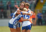 1 July 2018; Laois players, from left, Amy Potts, Jane Moore and Caoimhe Simms celebrate with Martina Phelan, backroom staff, after the TG4 Leinster Intermediate Championship Final match between Laois and Wicklow at Netwatch Cullen Park, Carlow. Photo by Piaras Ó Mídheach/Sportsfile