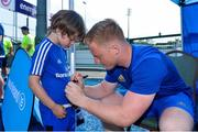 4 July 2018; Leinster player James Tracy with summer camp attendee Noah Humphrey, age 6, from Clontarf, Co Dublin, during the Bank of Ireland Leinster Rugby Summer Camp at Energia Park in Donnybrook, Dublin. Photo by David Fitzgerald/Sportsfile