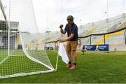 4 July 2018; Groundsman Stephen Forrest puts out the flags before the Bord Gáis Energy Munster GAA Hurling U21 Championship Final match between Cork and Tipperary at Pairc Ui Chaoimh in Cork. Photo by Matt Browne/Sportsfile