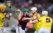 4 July 2018; Evan Niland of Galway in action against Damien Reck, left, Rory O'Connor, and Aaron Maddock, right, of Wexford during the Bord Gais Energy Leinster Under 21 Hurling Championship 2018 Final match between Wexford and Galway at O'Moore Park in Portlaoise, Co Laois. Photo by Sam Barnes/Sportsfile