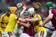 4 July 2018; Evan Niland of Galway in action against Damien Reck, left, and Rory O'Connor of Wexford during the Bord Gais Energy Leinster Under 21 Hurling Championship 2018 Final match between Wexford and Galway at O'Moore Park in Portlaoise, Co Laois. Photo by Sam Barnes/Sportsfile
