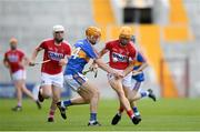 4 July 2018; Billy Hennessy of Cork in action against Jake Morris of Tipperary during the Bord Gáis Energy Munster GAA Hurling U21 Championship Final match between Cork and Tipperary at Pairc Ui Chaoimh in Cork. Photo by Eóin Noonan/Sportsfile