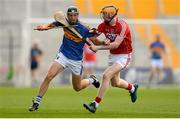 4 July 2018; Colin English of Tipperary in action against Conor Cahalane of Cork during the Bord Gáis Energy Munster GAA Hurling U21 Championship Final match between Cork and Tipperary at Pairc Ui Chaoimh in Cork. Photo by Eóin Noonan/Sportsfile