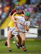 4 July 2018; Eanna Murphy of Galway in action against Rory Higgins of Wexford during the Bord Gais Energy Leinster Under 21 Hurling Championship 2018 Final match between Wexford and Galway at O'Moore Park in Portlaoise, Co Laois. Photo by Harry Murphy/Sportsfile