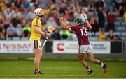 4 July 2018; Evan Niland of Galway celebrates scoring his side's third goal as Arraon Maddock of Wexford looks dejected during the Bord Gais Energy Leinster Under 21 Hurling Championship 2018 Final match between Wexford and Galway at O'Moore Park in Portlaoise, Co Laois. Photo by Harry Murphy/Sportsfile