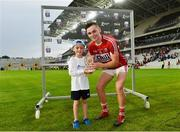 4 July 2018; Mason McDonnell, age 6, from Ballincollig, Cork, presents Mark Coleman of Cork with his Bord Gáis Energy Man of the Match award following the meeting of Cork and Tipperary in the Bord Gáis Energy GAA Hurling U21 Munster Championship Final at Páirc Uí Chaoimh. Bord Gáis Energy offers its customers unmissable rewards throughout the Championship season, including match tickets and hospitality, access to training camps with Hurling stars and the opportunity to present Man of the Match Awards at U21 games. Photo by Matt Browne/Sportsfile