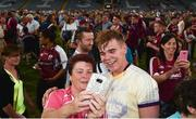 4 July 2018; Jack Canning of Galway poses for a selfie with a supporter following the Bord Gais Energy Leinster Under 21 Hurling Championship 2018 Final match between Wexford and Galway at O'Moore Park in Portlaoise, Co Laois. Photo by Sam Barnes/Sportsfile