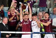 4 July 2018; Galway captain Fintan Burke of Galway lifts the cup along side Darragh Gilligan, centre, and Jack Fitzpatrick following the Bord Gais Energy Leinster Under 21 Hurling Championship 2018 Final match between Wexford and Galway at O'Moore Park in Portlaoise, Co Laois. Photo by Sam Barnes/Sportsfile
