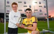 4 July 2018; Daniel Jordan, aged 7, from Oranmore, Co.Galway presents Rory O'Connor of Wexford with his Bord Gáis Energy Man of the Match award following the meeting of Wexford and Galway in the Bord Gáis Energy GAA Hurling U21 Munster Championship Final at O'Moore Park, Portlaoise. Bord Gáis Energy offers its customers unmissable rewards throughout the Championship season, including match tickets and hospitality, access to training camps with Hurling stars and the opportunity to present Man of the Match Awards at U21 games. Photo by Harry Murphy/Sportsfile