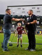 4 July 2018; Oisin Hallabert, aged 4, grandson of  Galway manager Tony Ward during an interview with Marcus Ó Buachalla after the Bord Gais Energy Leinster Under 21 Hurling Championship 2018 Final match between Wexford and Galway at O'Moore Park in Portlaoise, Co Laois. Photo by Harry Murphy/Sportsfile