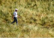 6 July 2018; Paul Dunne of Ireland makes his way to the 7th green during Day Two of the Dubai Duty Free Irish Open Golf Championship at Ballyliffin Golf Club in Ballyliffin, Co. Donegal. Photo by Ramsey Cardy/Sportsfile