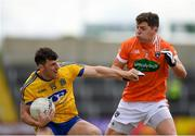 7 July 2018; Diarmuid Murtagh of Roscommon in action against Patrick Burns of Armagh during the GAA Football All-Ireland Senior Championship Round 4 match between Roscommon and Armagh at O'Moore Park in Portlaoise, Co. Laois. Photo by Eóin Noonan/Sportsfile