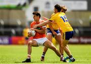 7 July 2018; Niall Grimley of Armagh is tackled by Diarmuid Murtagh of Roscommon during the GAA Football All-Ireland Senior Championship Round 4 match between Roscommon and Armagh at O'Moore Park in Portlaoise, Co. Laois. Photo by Eóin Noonan/Sportsfile