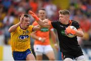 7 July 2018; Blaine Hughes of Armagh in action against Niall Kilroy of Roscommon during the GAA Football All-Ireland Senior Championship Round 4 match between Roscommon and Armagh at O'Moore Park in Portlaoise, Co. Laois. Photo by Eóin Noonan/Sportsfile