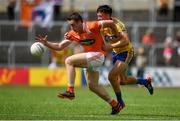 7 July 2018; Charlie Vernon of Armagh in action against Tadgh O'Rourke of Roscommon during the GAA Football All-Ireland Senior Championship Round 4 match between Roscommon and Armagh at O'Moore Park in Portlaoise, Co. Laois. Photo by Brendan Moran/Sportsfile