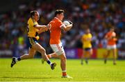7 July 2018; Patrick Burns of Armagh in action against Niall Kilroy of Roscommon during the GAA Football All-Ireland Senior Championship Round 4 match between Roscommon and Armagh at O'Moore Park in Portlaoise, Co. Laois. Photo by Eóin Noonan/Sportsfile