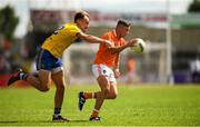 7 July 2018; Ryan McShane of Armagh in action against Enda Smith of Roscommon during the GAA Football All-Ireland Senior Championship Round 4 match between Roscommon and Armagh at O'Moore Park in Portlaoise, Co. Laois. Photo by Eóin Noonan/Sportsfile