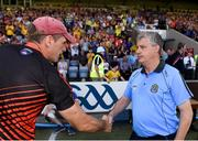 7 July 2018; Roscommon manager Kevin McStay shakes hands with Armagh manager Kieran McGeeney following the GAA Football All-Ireland Senior Championship Round 4 match between Roscommon and Armagh at O'Moore Park in Portlaoise, Co. Laois. Photo by Eóin Noonan/Sportsfile