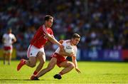 7 July 2018; Niall Sludden of Tyrone in action against Cian Kelly of Cork during the GAA Football All-Ireland Senior Championship Round 4 between Cork and Tyrone at O'Moore Park in Portlaoise, Co. Laois. Photo by Eóin Noonan/Sportsfile