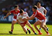 7 July 2018; Cathal McShane of Tyrone in action against Stephen Cronin and Cian Kelly of Cork during the GAA Football All-Ireland Senior Championship Round 4 between Cork and Tyrone at O'Moore Park in Portlaoise, Co. Laois. Photo by Eóin Noonan/Sportsfile