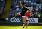 7 July 2018; Niall Morgan of Tyrone in action against Luke Connolly of Cork during the GAA Football All-Ireland Senior Championship Round 4 between Cork and Tyrone at O'Moore Park in Portlaoise, Co. Laois. Photo by Eóin Noonan/Sportsfile