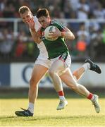 30 June 2018; James Durcan of Mayo in action against Peter Kelly of Kildare during the GAA Football All-Ireland Senior Championship Round 3 match between Kildare and Mayo at St Conleth's Park in Newbridge, Kildare. Photo by Piaras Ó Mídheach/Sportsfile
