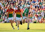 7 July 2018; Kyle Hayes of Limerick in action against Richard Coady, 7, and Denis Murphy of Carlow during the GAA Hurling All-Ireland Senior Championship Preliminary Quarter-Final match between Carlow and Limerick at Netwatch Cullen Park in Carlow. Photo by Matt Browne/Sportsfile