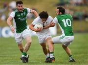 7 July 2018; Chris Healy of Kildare in action against Séamus Quigley, left, and Paul McCusker of Fermanagh during the GAA Football All-Ireland Senior Championship Round 4 match between Fermanagh and Kildare at Páirc Tailteann in Navan, Co. Meath. Photo by Piaras Ó Mídheach/Sportsfile