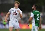7 July 2018; Daniel Flynn of Kildare celebrates a point as Kane Connor of Fermanagh looks on during the GAA Football All-Ireland Senior Championship Round 4 match between Fermanagh and Kildare at Páirc Tailteann in Navan, Co. Meath. Photo by Piaras Ó Mídheach/Sportsfile