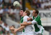 7 July 2018; Daniel Flynn of Kildare in action against Barry Mulrone, left, and Che Cullen of Fermanagh during the GAA Football All-Ireland Senior Championship Round 4 match between Fermanagh and Kildare at Páirc Tailteann in Navan, Co. Meath. Photo by Piaras Ó Mídheach/Sportsfile