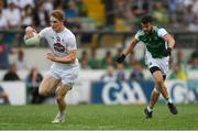 7 July 2018; Daniel Flynn of Kildare gets past James McMahon of Fermanagh during the GAA Football All-Ireland Senior Championship Round 4 match between Fermanagh and Kildare at Páirc Tailteann in Navan, Co. Meath. Photo by Piaras Ó Mídheach/Sportsfile
