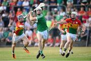 7 July 2018; Kyle Hayes of Limerick in action against Diarmuid Byrne and Kevin McDonald of Carlow during the GAA Hurling All-Ireland Senior Championship Preliminary Quarter-Final match between Carlow and Limerick at Netwatch Cullen Park in Carlow. Photo by Matt Browne/Sportsfile