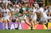 7 July 2018; Eoin Donnelly of Fermanagh in action against Kevin Flynn and Mick O'Grady, right, of Kildare during the GAA Football All-Ireland Senior Championship Round 4 match between Fermanagh and Kildare at Páirc Tailteann in Navan, Co. Meath. Photo by Piaras Ó Mídheach/Sportsfile