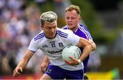 8 July 2018; Conor McCarthy of Monaghan in action against Damien O'Connor of Laois during the GAA Football All-Ireland Senior Championship Round 4 match between Laois and Monaghan at Páirc Tailteann in Navan, Co Meath. Photo by Ramsey Cardy/Sportsfile