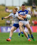 8 July 2018; Kieran Hughes of Monaghan is tackled by Eoin Lowry of Laois during the GAA Football All-Ireland Senior Championship Round 4 match between Laois and Monaghan at Páirc Tailteann in Navan, Co Meath. Photo by Ramsey Cardy/Sportsfile