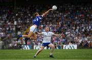 8 July 2018; Shane Nerney of Laois in action against Ryan McAnespie of Monaghan during the GAA Football All-Ireland Senior Championship Round 4 match between Laois and Monaghan at Páirc Tailteann in Navan, Co Meath. Photo by Ramsey Cardy/Sportsfile
