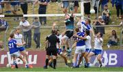 8 July 2018; Rory Beggan of Monaghan clears possession despite the efforts by Kieran Lillis of Laois during the GAA Football All-Ireland Senior Championship Round 4 match between Laois and Monaghan at Páirc Tailteann in Navan, Co Meath. Photo by Ramsey Cardy/Sportsfile