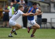 8 July 2018; Seán Doody of Wicklow in action against Drew Costello of Kildare during the Electric Ireland Leinster GAA Minor Football Championship Semi-Final match between Kildare and Wicklow at St Conleth's Park in Newbridge, Co. Kildare. Photo by Piaras Ó Mídheach/Sportsfile