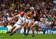8 July 2018; Ger Aylward of Kilkenny squeezes past Galway goalkeeper James Skehill, left, and Gearóid McInerney of Galway on his way to score a goal inthe 34th minute during the Leinster GAA Hurling Senior Championship Final Replay match between Kilkenny and Galway at Semple Stadium in Thurles, Co Tipperary. Photo by Ray McManus/Sportsfile