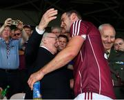 8 July 2018;  President Michael D Higgins congratulates Galway captain David Burke as he arrives for the presentation of the Bob O'Keeffe Cup after the Leinster GAA Hurling Senior Championship Final Replay match between Kilkenny and Galway at Semple Stadium in Thurles, Co Tipperary. Photo by Ray McManus/Sportsfile