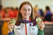 9 July 2018; Ireland's Sarah Healy, Blackrock AC, Dublin, with her gold medals for winning the Girls 1500m and 3000m events, during the Team Ireland homecoming from the European Athletics Under-18 Championships in Gyor, Hungary, at Dublin Airport in Dublin. Photo by Piaras Ó Mídheach/Sportsfile