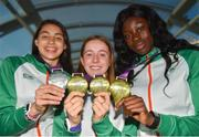 9 July 2018; Team Ireland athletes, from left, Sophie O'Sullivan, Ballymore Cobh AC, Cork, with her silver medal she won in the Girls 800m event, Sarah Healy, Blackrock AC, Dublin, with her gold medals for winning the Girls 1500m and 3000m events, and Rhasidat Adeleke, Tallaght AC, Dublin, with her gold medal for winning the Girls 200m event, during the Team Ireland homecoming from the European Athletics Under-18 Championships in Gyor, Hungary, at Dublin Airport in Dublin. Photo by Piaras Ó Mídheach/Sportsfile