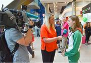 9 July 2018; Ireland's Sarah Healy, Blackrock AC, Dublin, with her gold medals for winning the Girls 1500m and 3000m events, is interviewed by RTÉ's Jacqui Hurley during the Team Ireland homecoming from the European Athletics Under-18 Championships in Gyor, Hungary, at Dublin Airport in Dublin. Photo by Piaras Ó Mídheach/Sportsfile