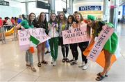 9 July 2018; Ireland's Sarah Healy, Blackrock AC, Dublin, with her gold medals for winning the Girls 1500m and 3000m events, is welcomed home by some of her friends during the Team Ireland homecoming from the European Athletics Under-18 Championships in Gyor, Hungary, at Dublin Airport in Dublin. Photo by Piaras Ó Mídheach/Sportsfile